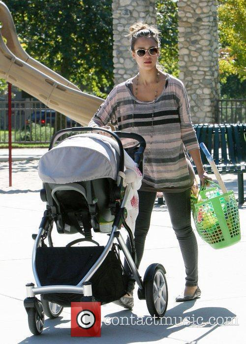 Jessica Alba pushes baby Haven Warren in a...