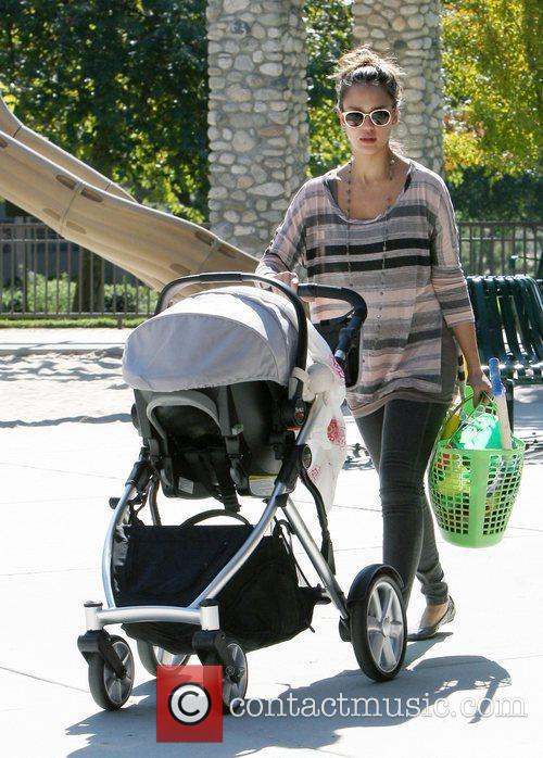 Jessica Alba pushes baby Haven Warren in a...