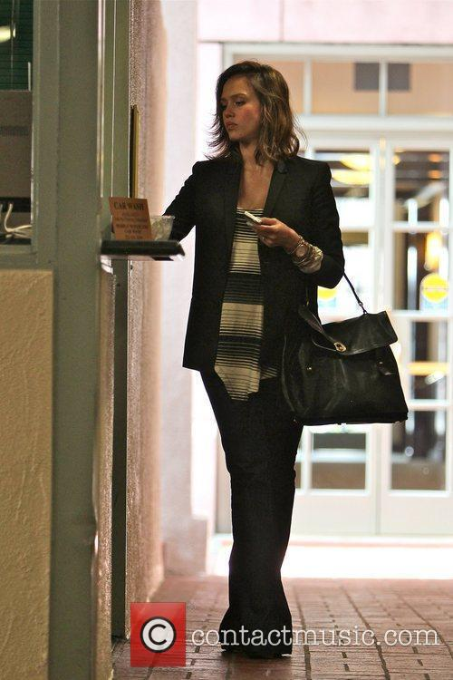 Jessica Alba picking up her car at the...