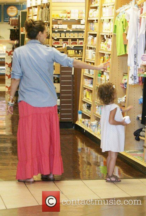 Takes their daughter Honor Marie Warren grocery shopping...