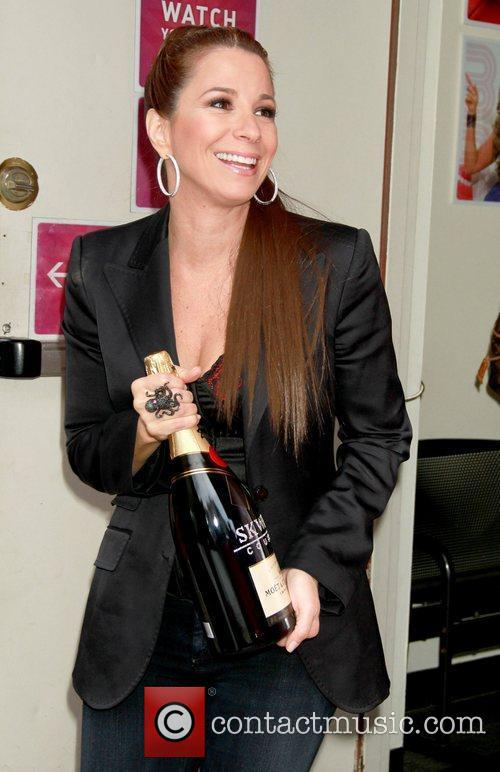 Jill Zarin holding a bottle Moet & Chandon...