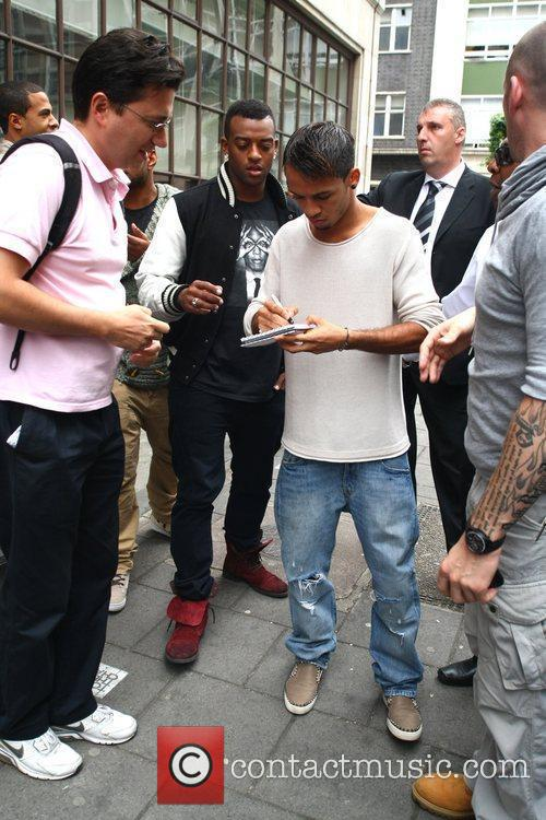 Oritse Williams and Aston Merrygold of JLS outside...
