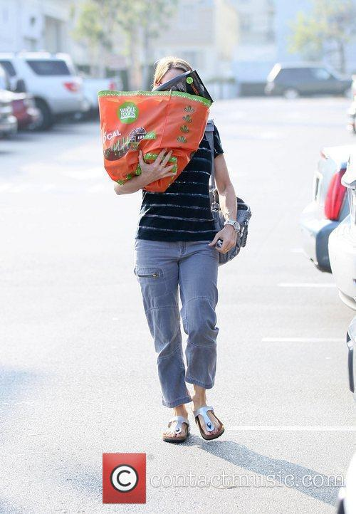 Jodie Foster hides her face with her reusable...