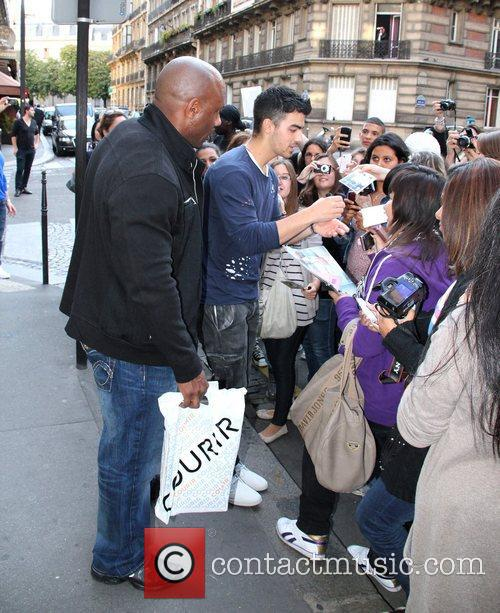 Joe Jonas meeting fans outside his hotel in...