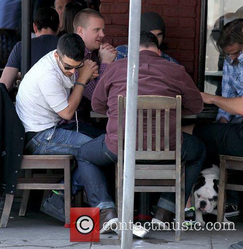 Joe Jonas having lunch with his dog Mugsy...