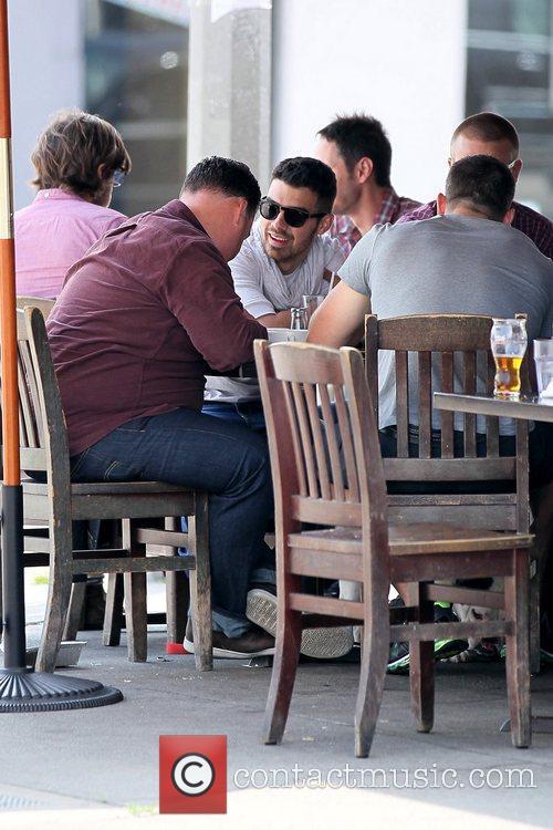Joe Jonas having lunch with his dog and...
