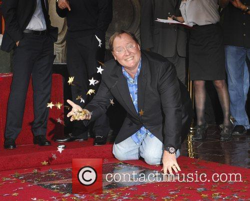 john lasseter honoured with a star on 3587866