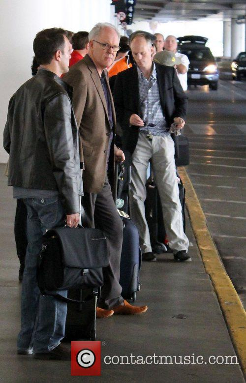 John Lithgow leaving LAX Airport in a taxi...