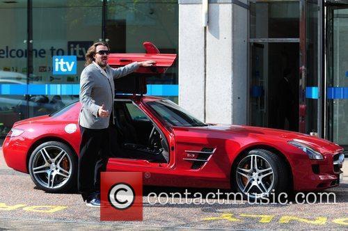 Shows off his Mercedes-Benz SLS car on loan...
