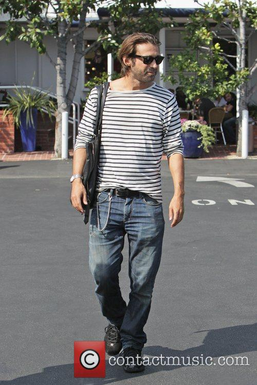 Spanish actor, Jordi Molla in a stripped t-shirt...