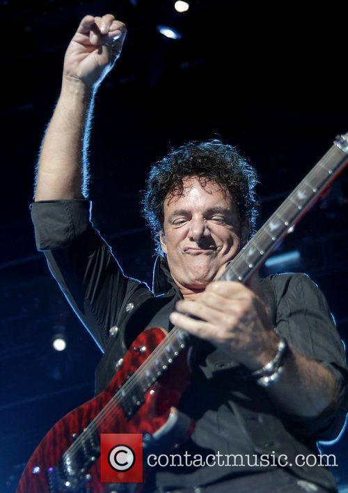 Neal Schon of Journey performing at Manchester MEN...