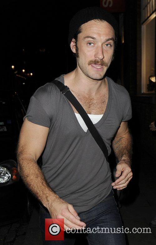 Jude Law sporting a moustache leaving the Donmar...