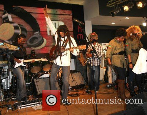 Julian Marley and The Uprising performing live to...