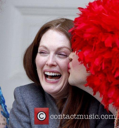 Julianne Moore laughing during a parade in her...