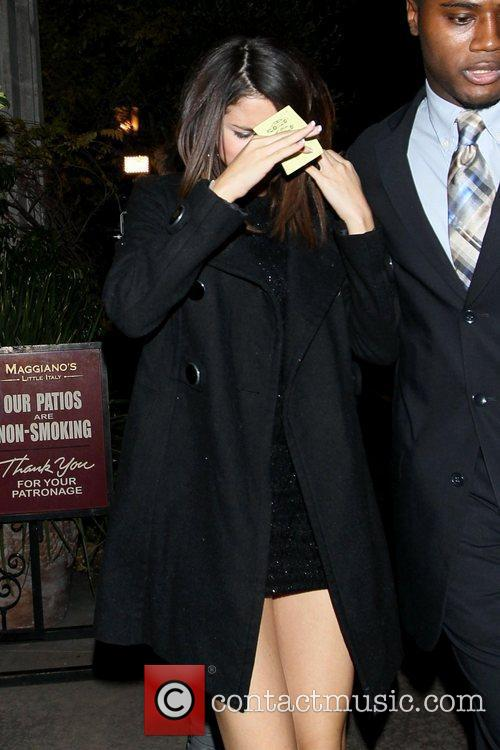 Selena Gomez  keeps her face covered as...