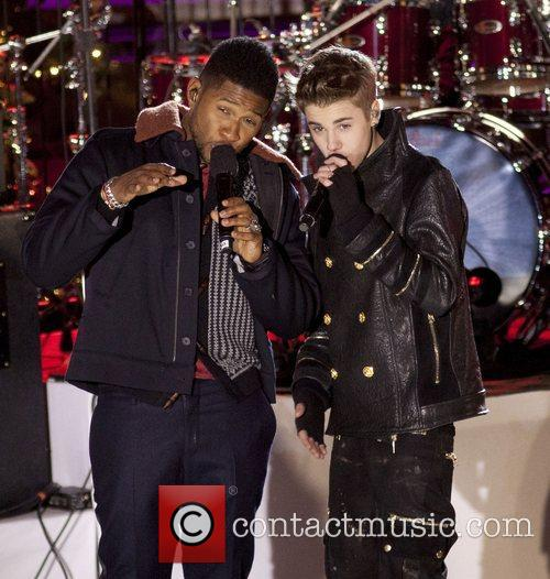 Justin Bieber and Usher perform for the pre-taping...