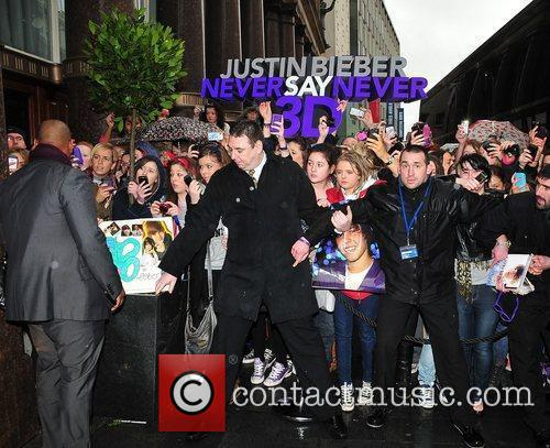 Justin Bieber fans gather outside the Hard Days...