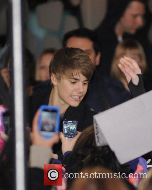 Justin Bieber  greeting fans outside the New...