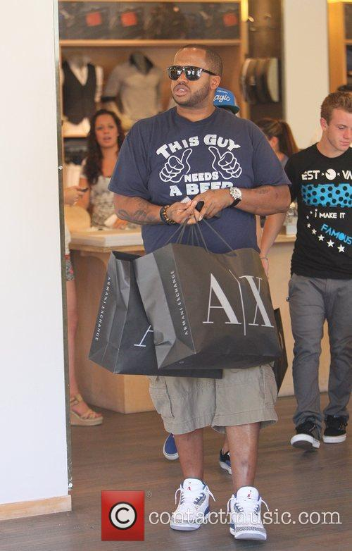Justin Bieber's bodyguard carrying his bags, as they...
