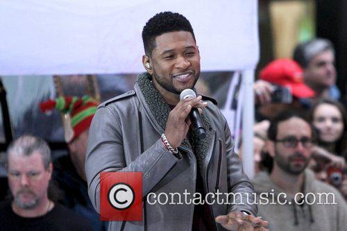 Justin Bieber and special guest Usher perform on...