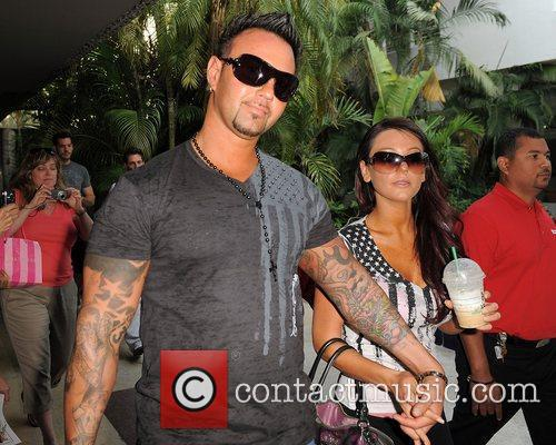 Jenni 'JWoww' Farley at GNC to promote her...