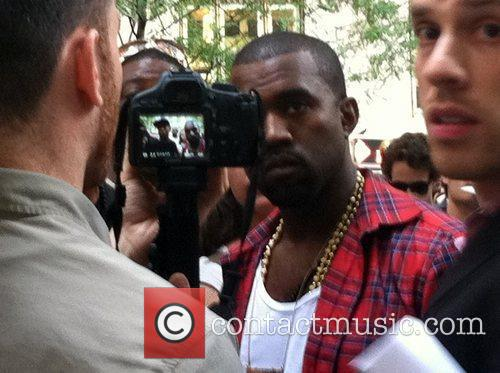 Kanye West visits the Occupy Wall Street demonstrations....