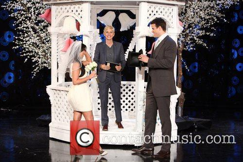Kim Kardashian and Kris Humphries, with Ellen DeGeneres...