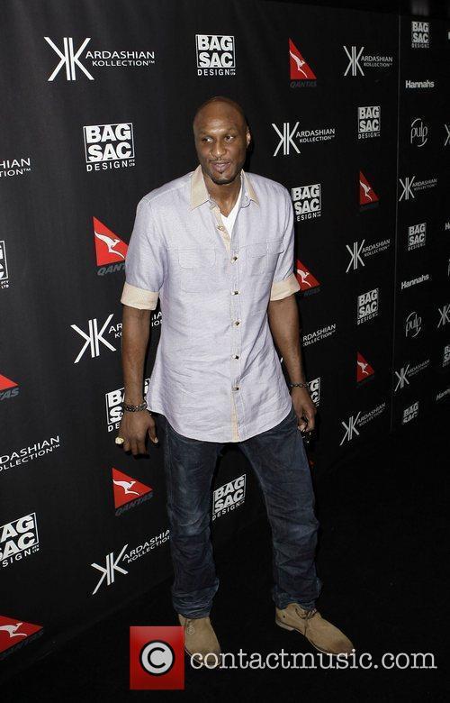 Lamar Odom The launch of Kardashian Kollection handbags...