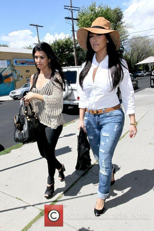 Kourtney Kardashian and Kim Kardashian 8