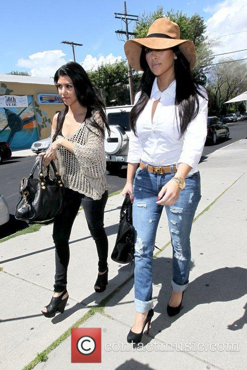 Kourtney Kardashian and Kim Kardashian 9