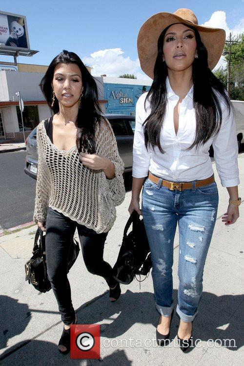 Kourtney Kardashian and Kim Kardashian 6