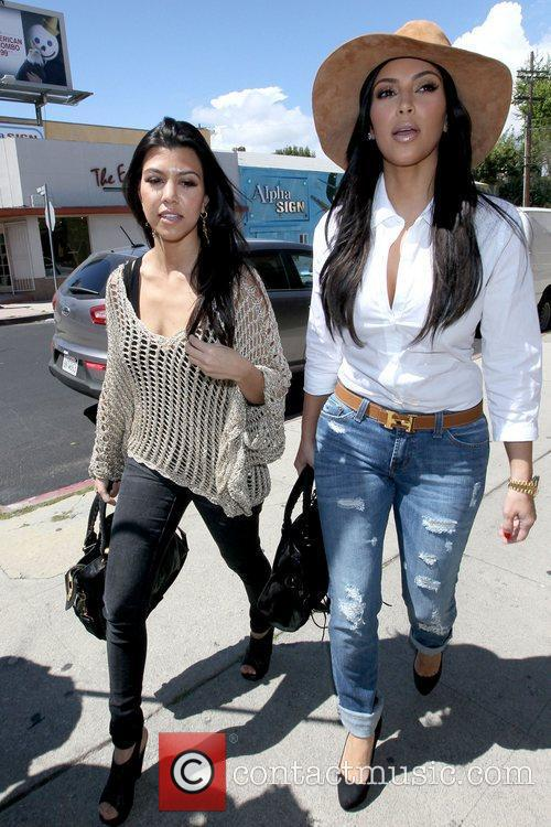 Kourtney Kardashian and Kim Kardashian 11