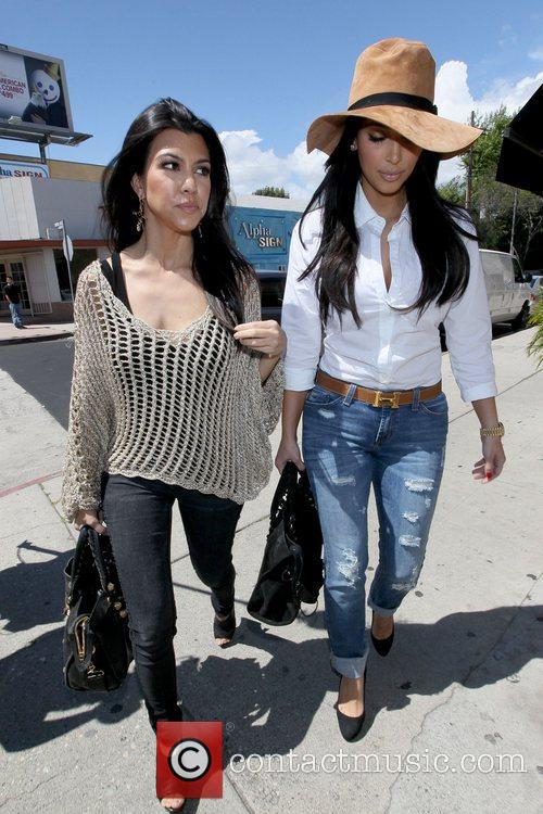 Kourtney Kardashian and Kim Kardashian 15