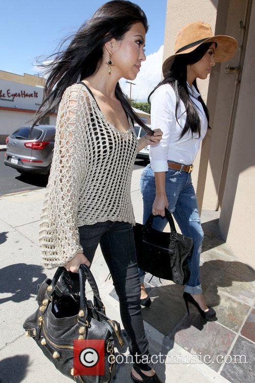 Kourtney Kardashian and Kim Kardashian 14
