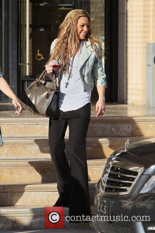 Leaves Barneys New York after shopping with a...
