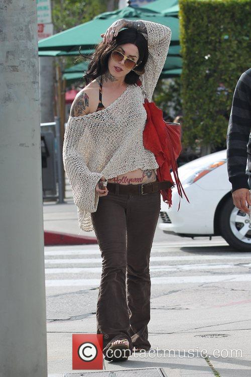 Is seen leaving Urth Cafe with a friend...