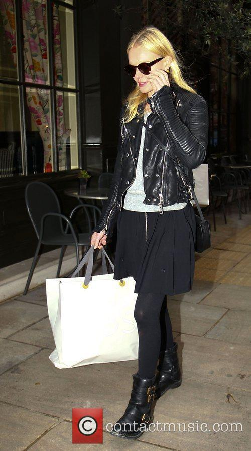 Leaving her hotel in central London