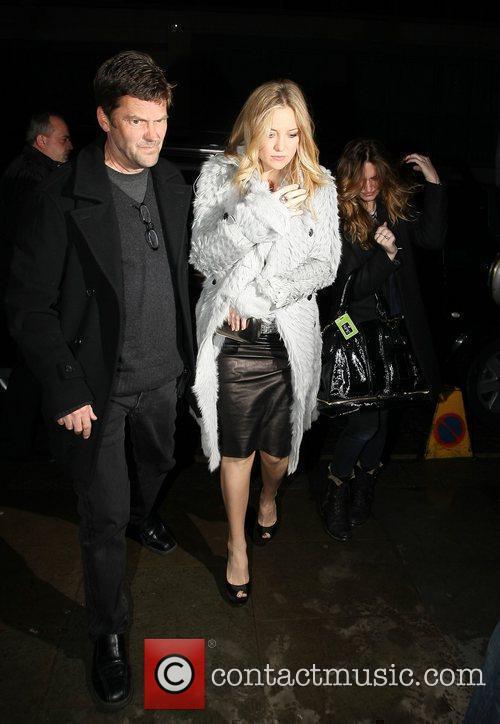 Kate Hudson in a grey fur coat at...