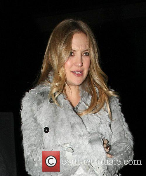 Kate Hudson in a grey fur coat at...