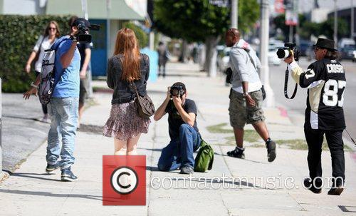 Kate Mara surrounded by photographers as she leaves...
