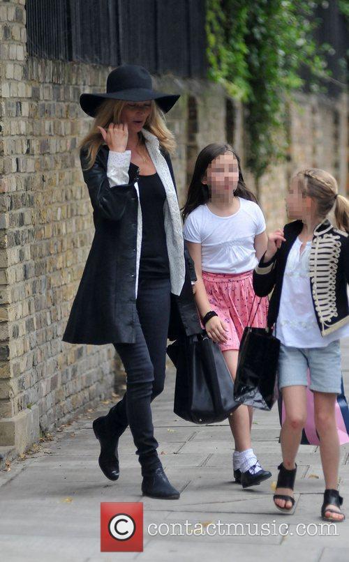 Kate Moss and daughter Lila Rose enjoying a...