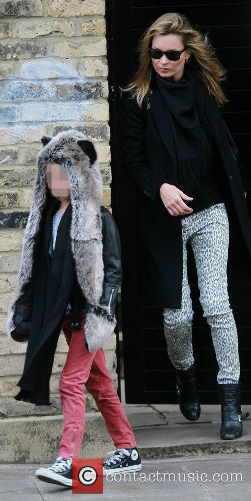 Kate Moss  leaving home with her daughter...