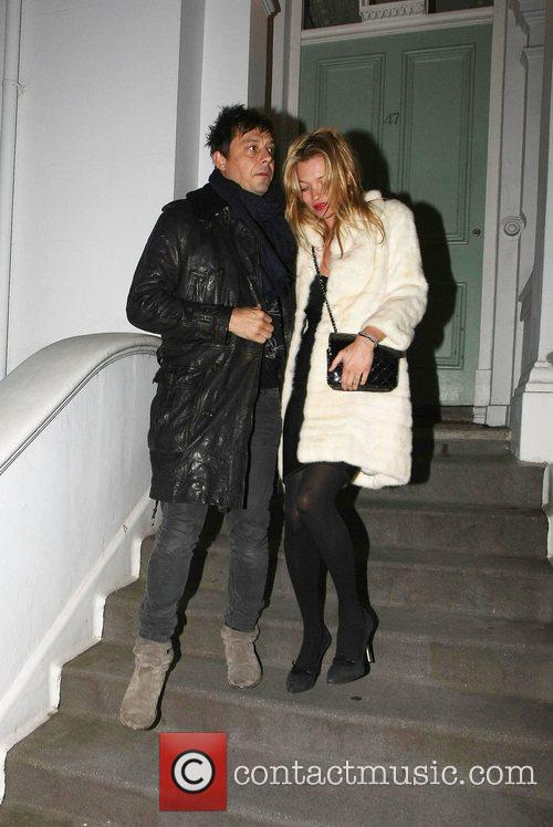 Newly engaged Jamie Hince and Kate Moss leave...