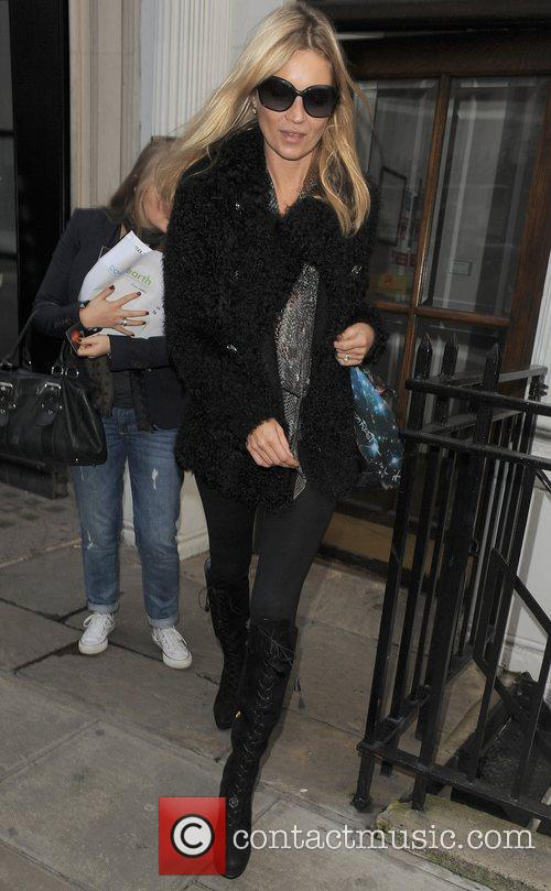 Kate Moss leaving an office building. London, England