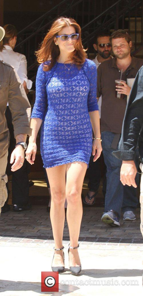 Kate Walsh arrives in a blue clingy dress...