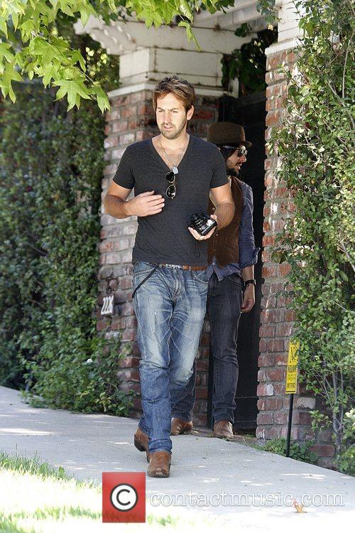 Josh Kelley leaving a private residence with his...