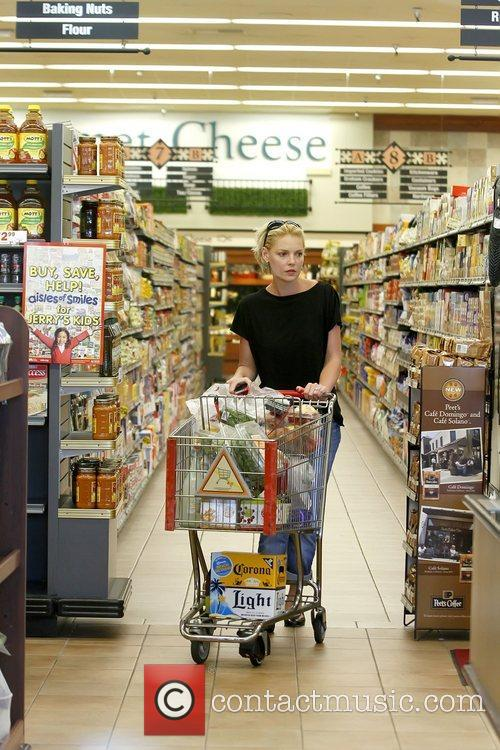 Shopping for groceries with her husband, after they...