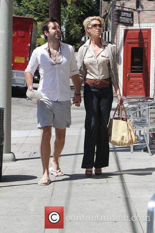 Katherine Heigl holding hands with her husband Josh...