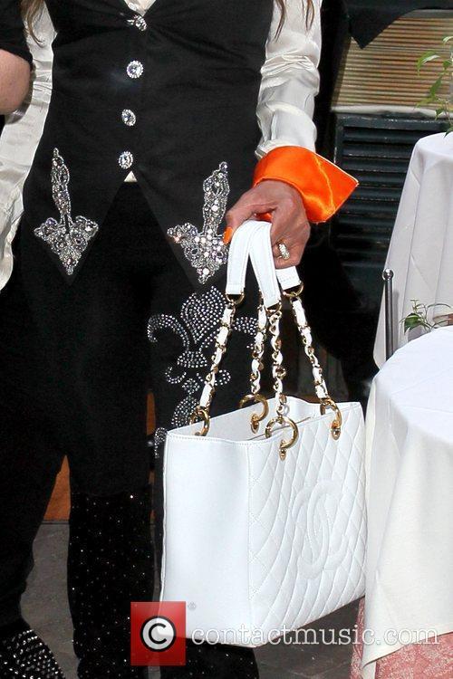 La Toya Jackson's handbag Celebrities depart Il Cielo...