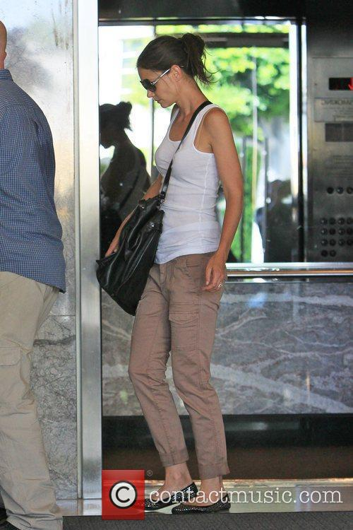 Katie Holmes seen leaving an office building in...